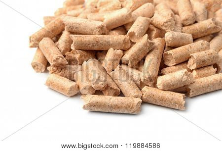 Close up of wood pellets on white background