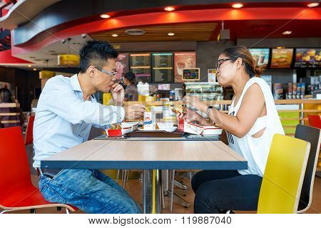 PATTAYA, THAILAND - FEBRUARY 25, 2016: people eat at McDonald's. McDonald's primarily sells hamburgers, cheeseburgers, chicken, french fries, breakfast items, soft drinks, milkshakes, and desserts