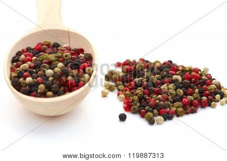 Mixture Pepper In Wooden Spoon On White Background