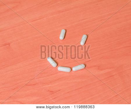Tablets Smiles On A Wooden Table