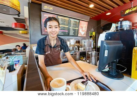 PATTAYA, THAILAND - FEBRUARY 25, 2016: worker at McCafe in Thailand. McCafe is a coffee-house-style food and drink chain, owned by McDonald's.