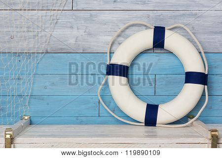 life buoy on wood background blue and white