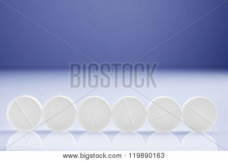 Six White Pills