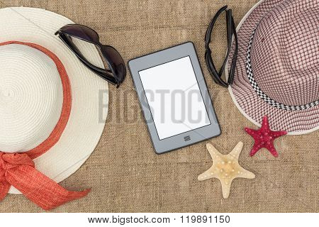 ebook hat and a starfish lie on sacking