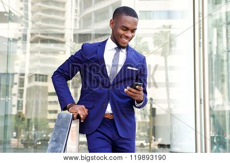 Young African Businessman Using Mobile Phone