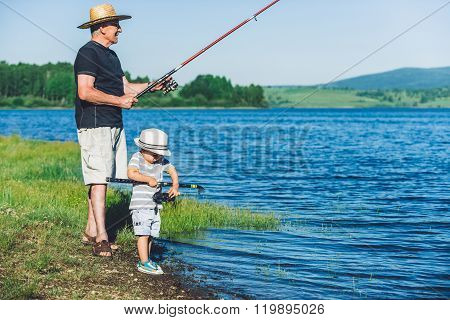 Little Boy Fishing With Grandfather