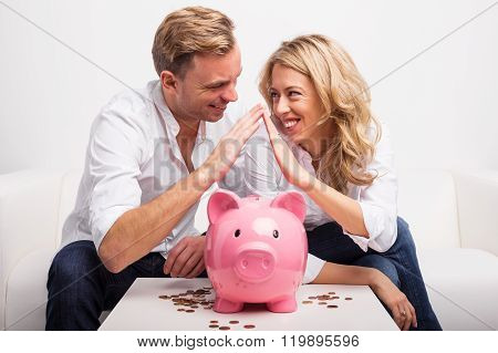 Couple saving money to buy house