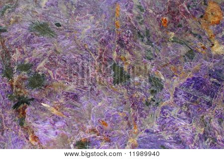 A Texture Of Natural Charoite Mineral.