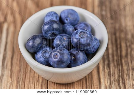 Super Food Bilberries In A White Cup