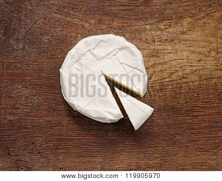 Creamy Brie On Rustic Wooden Background