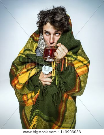 Ill Man Covered With Plaid Blanket With Hot Tea/