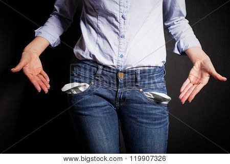 Woman pointing at her pants and showing empty pockets