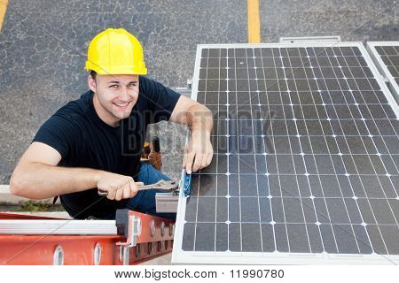 Electrician installing solar panels on the roof of a building.