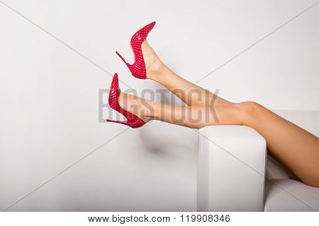 Sexy woman's legs in red high heels