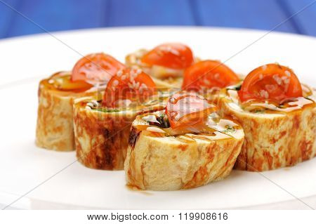Yummy Japan Omelette Rolls With Tomatoes Served On White Plate