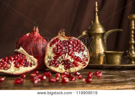 Pomegranate on a dark wooden board