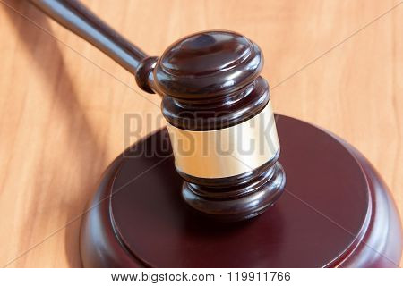 Judicial Hammer  On A Wooden Table
