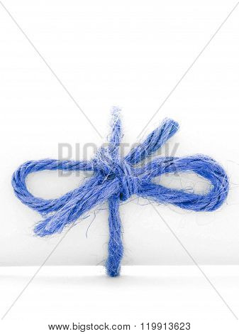 Handmade Blue Rope Node Tied On White Message Roll Isolated