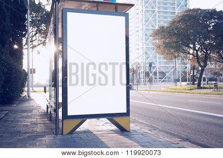 Photo blank lightbox on bus stop in the modern city. Horizontal mockup, sunlight