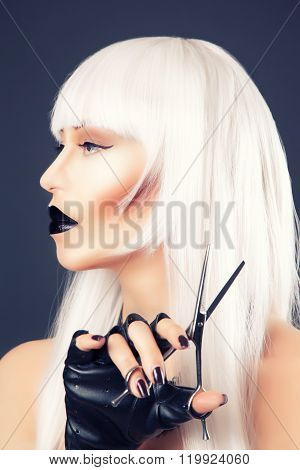Beautiful Blonde Woman With Black Make-up And Accessories Posing With Scissors