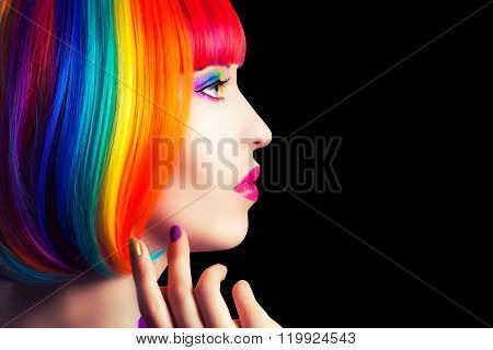 Beautiful Woman Wearing Colorful Wig And Showing Colorful Nails Against Wooden Background