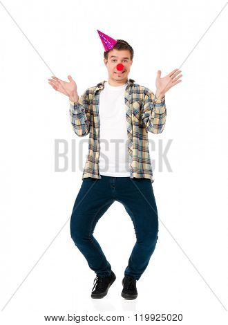 Man with red clown nose and birthday cap, isolated on white background