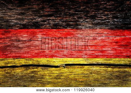 Germany Flag Painted On The Old Cracked Wood With Worn-out Paint. Grunge Look.