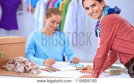 Young fashion designer working at studio.