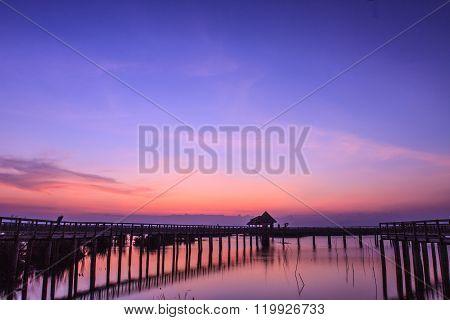 Wooden Bridge In Lotus Lake On Sunset Time