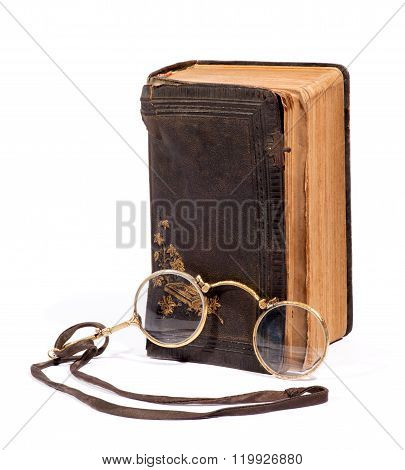 Vintage Pince-nez Glasses With An Old Book