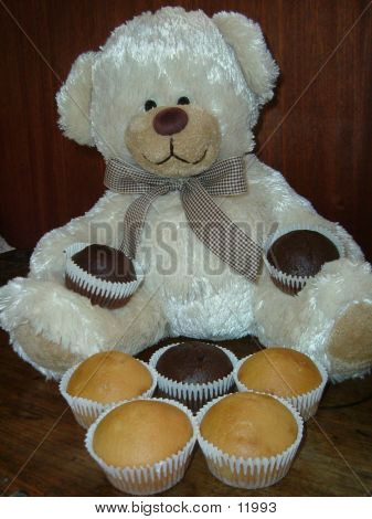 Teddy Smiling With Two Cakes