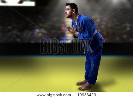 Judoka fighter isolated on white background