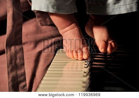 Feet Of Small Boy On Piano