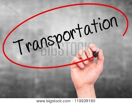 Man Hand Writing Transportation With Black Marker On Visual Screen.