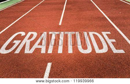 Gratitude written on running track