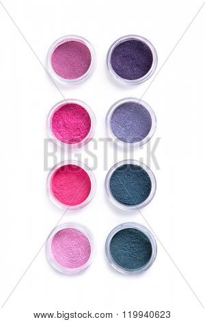 Set of bright mineral eye shadows, top view isolated on white background
