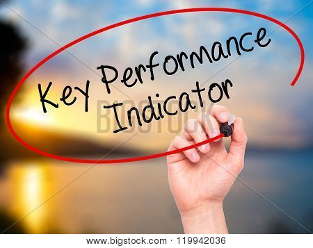 Man Hand Writing Key Performance Indicator With Black Marker On Visual Screen.