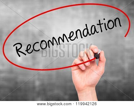 Man Hand Writing Recommendation  With Black Marker On Visual Screen.