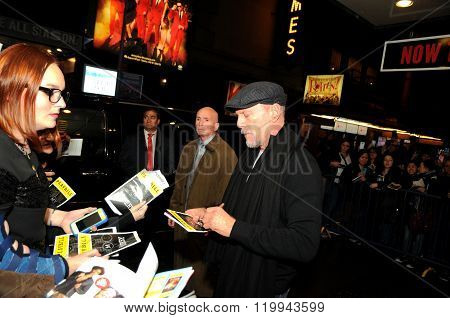 The famous actor Bruce Willis signing autographs