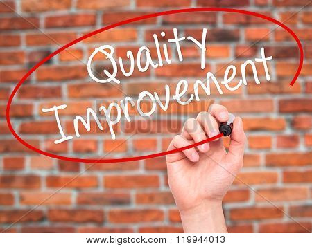Man Hand Writing Quality Improvement With Black Marker On Visual Screen.