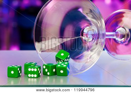 Gamble dice and cocktail martini glass