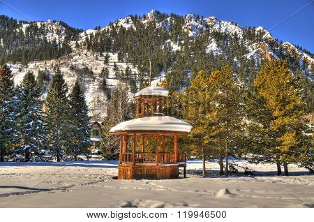 Beautiful gazebo partially covered with snow in Aspen Colorado