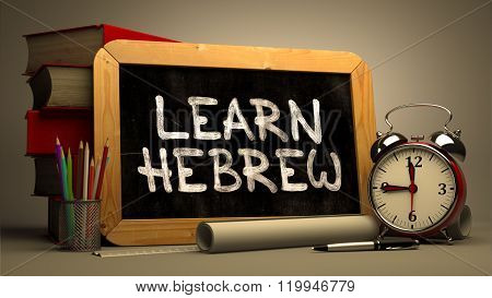 Hand Drawn Learn Hebrew Concept on Chalkboard.