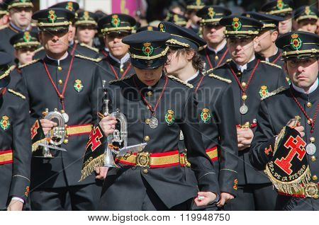 Band Members Marching In A Procession