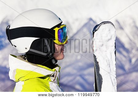 Woman with ski mask and helmet over snow mountain