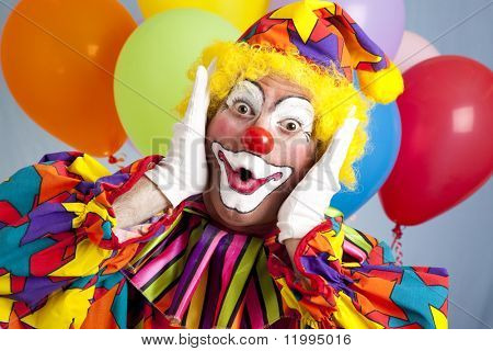 Birthday clown in full costume, looking surprised.