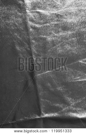 Silver cloth texture with uneven crumpled surface