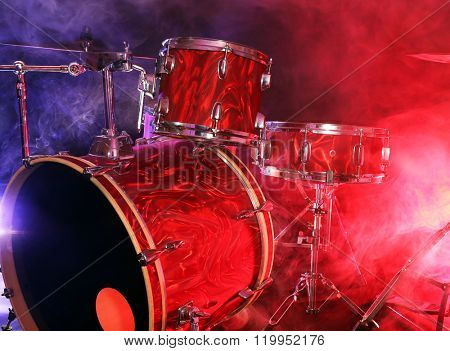 Drum set in smoke on a stage