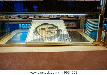 ISTANBUl TURKEY - JUL 28 2009: Barack Obama face made from Turkish Baklava by Nidir Gullu Baklava shop in Istanbul Turkey - iconic place attended by President of the United State in 2009