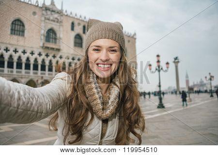 Woman Tourist Taking Selfie On St.mark's Square Near Dogi Palace